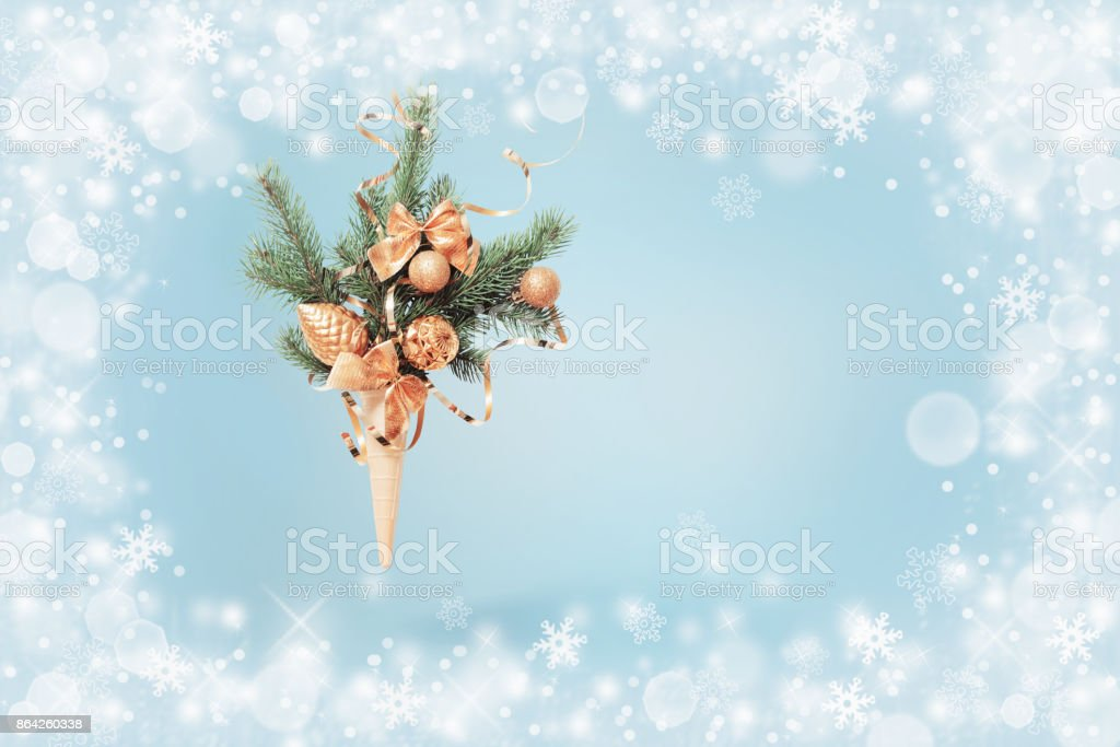 Christmas fir in waffle cone on blue background royalty-free stock photo