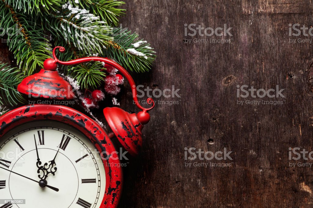 Christmas fir tree and alarm clock stock photo