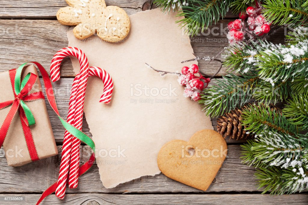 Christmas fir tree and gingerbread cookies stock photo