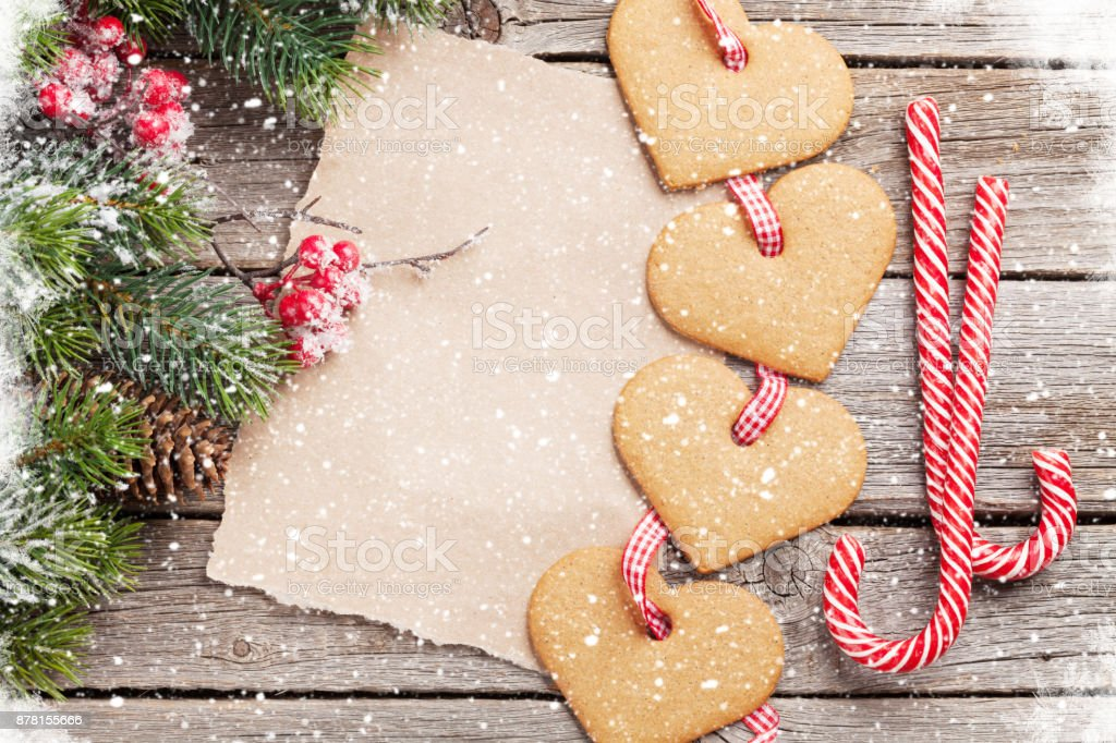 Christmas fir tree and heart gingerbread cookies stock photo