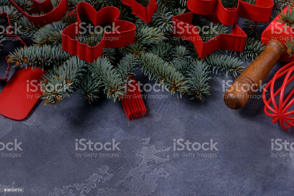 Christmas fir tree and red cookies cutters stock photo
