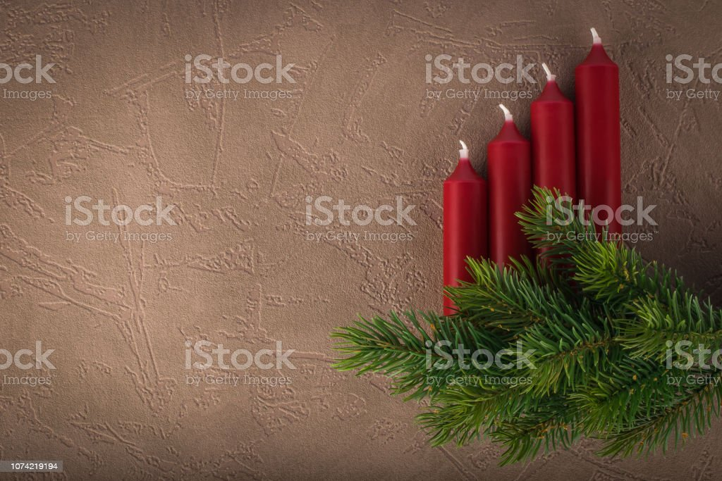 Christmas fir tree branch with 4 advent candles