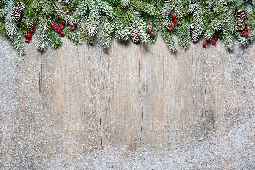 Christmas fir tree on a wooden board stock photo