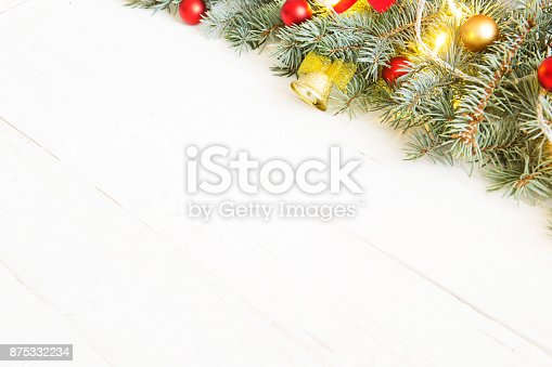istock Christmas fir tree with christmas decoration on a white wooden board 875332234