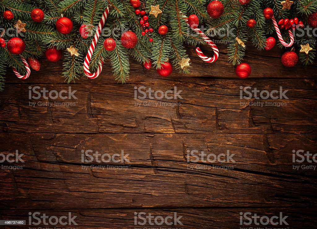 Christmas fir tree with decoration on a wooden board stock photo