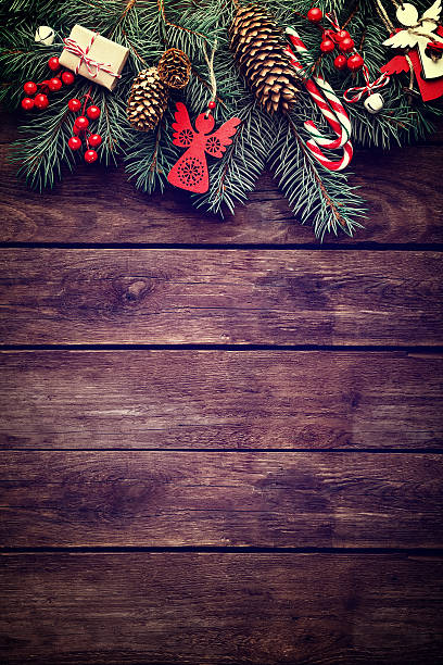 Christmas fir tree with decoration on dark wooden background stock photo