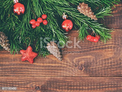 istock Christmas fir tree with decoration on wooden background 872150450