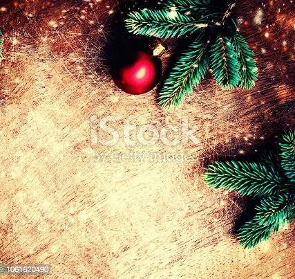 istock Christmas fir tree with decorations on dark grunge wooden board. Christmas vintage Background, copy space. Flat lay, Top view. 1061620490