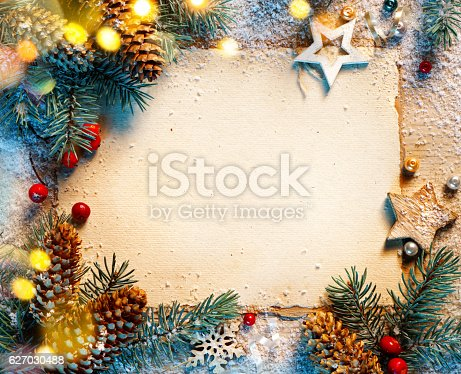 istock Christmas fir tree with greeting card 627030488