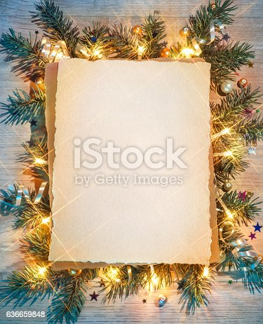 istock Christmas fir tree with greeting paper. 636659848