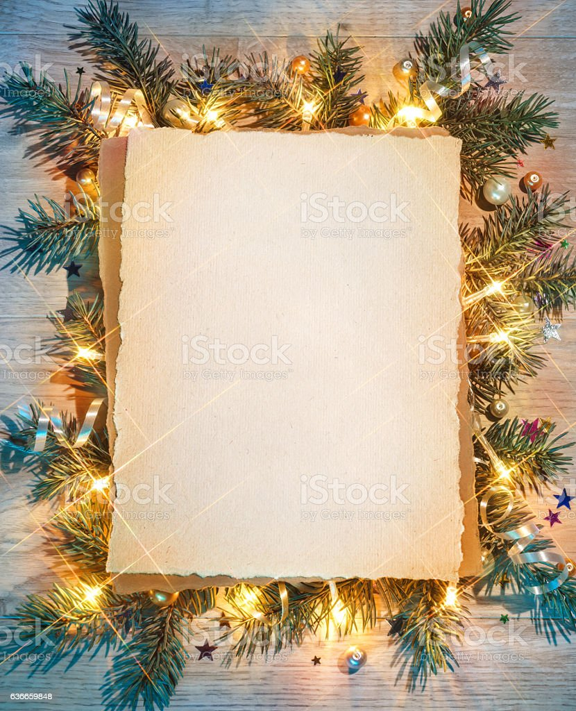 Christmas fir tree with greeting paper. stock photo