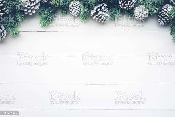 Christmas fir tree with pine branch decoration on white wood picture id857789462?b=1&k=6&m=857789462&s=612x612&h=yvapsink j pt5fi9fem9voazvolqx7fdvllfbywb1g=