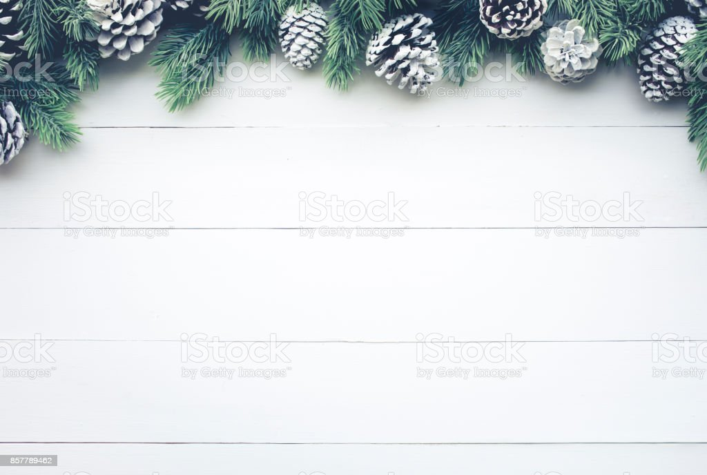 Christmas fir tree with pine branch decoration on white wood. stock photo