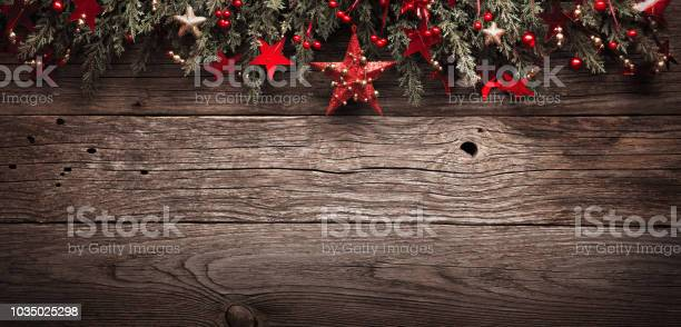 Christmas fir tree with red star on wooden background picture id1035025298?b=1&k=6&m=1035025298&s=612x612&h=rk5ebxujtrkkq8l0wepwwobdy7llhl0h ndjpn0d1fg=