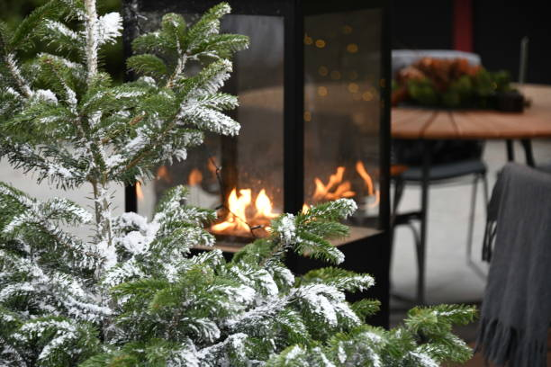 christmas fire and tree in denmark - christmas stock photos and pictures