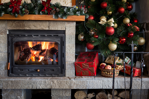 Christmas Fireplace Screen.Christmas Fireplace And Tree Decorated With Baubles Stock Photo Download Image Now