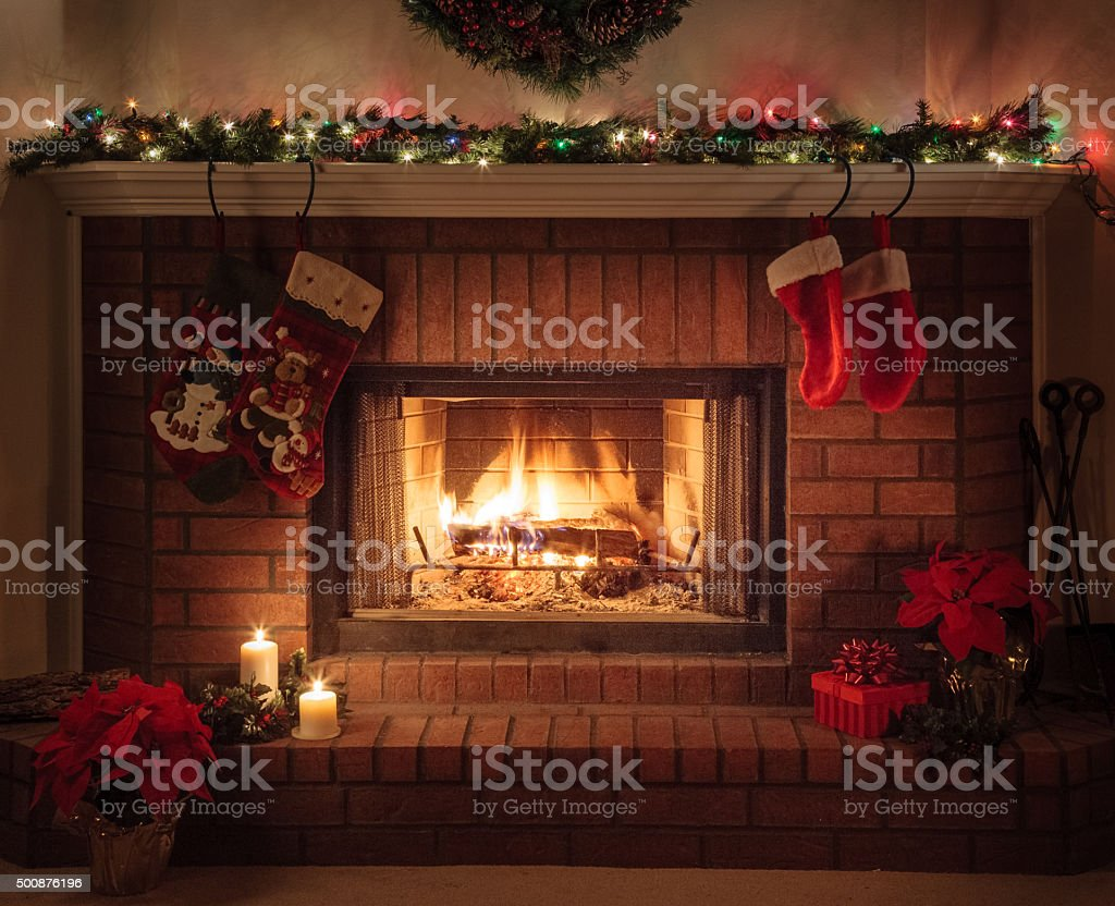 Christmas Fireplace, holiday decorations, cozy fire stock photo