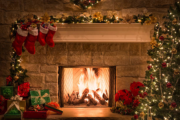 christmas fireplace, stockings, gifts, tree, copy space - fireplace stockfoto's en -beelden