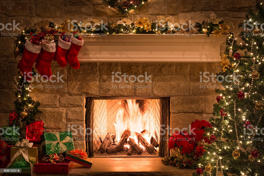 Christmas fireplace, stockings, gifts, tree, copy space stock photo
