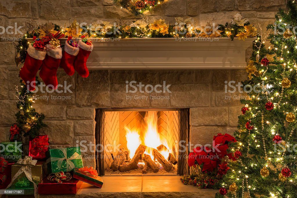 Christmas fireplace, tree, stockings, fire, hearth, lights, decorations stock photo