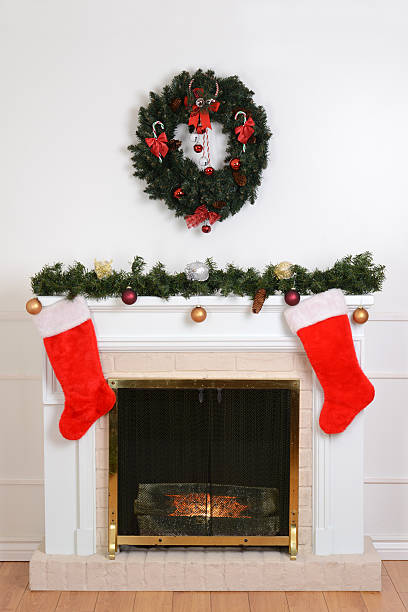 christmas fireplace with santa socks - garland decoration stock photos and pictures