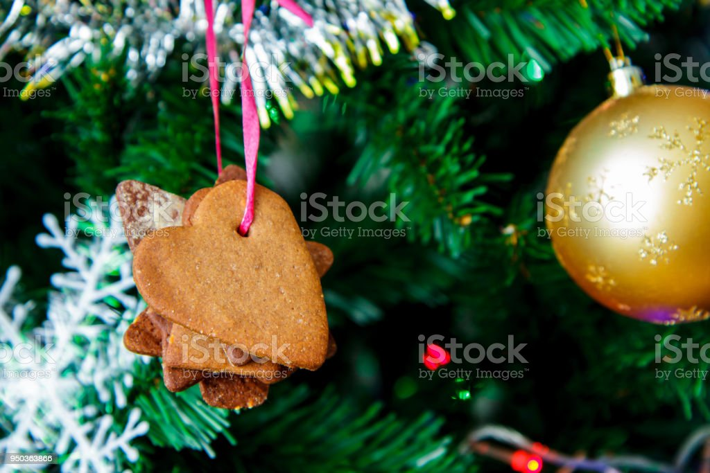 Christmas fir-tree with a ball, biscuits and snowflakes stock photo