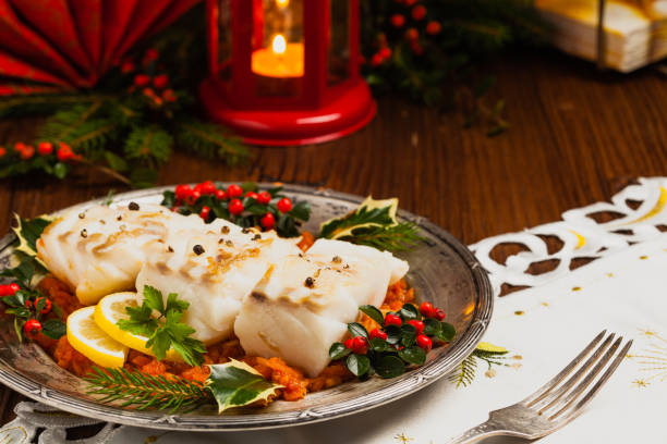 christmas fish. roasted cod pieces, served in vegetable sauce. - cod imagens e fotografias de stock