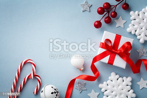 1076063742 istock photo Christmas flat lay. Gift or present box, white snowflakes and holiday decoration top view. Happy New Year card. 1178588791