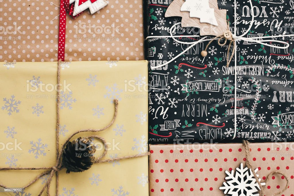 christmas flat lay. stylish wrapped gift boxes top view, with ornaments and twine. merry christmas and happy new year concept. seasonal greetings, happy holidays royalty-free stock photo