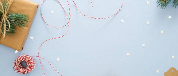 Christmas flatlay composition on blue background top view gift box picture id1175684915?b=1&k=6&m=1175684915&s=612x612&w=0&h=fwax45gcsoicbo8uzkpzbsje 7dajvxwerijyjlq3ao=