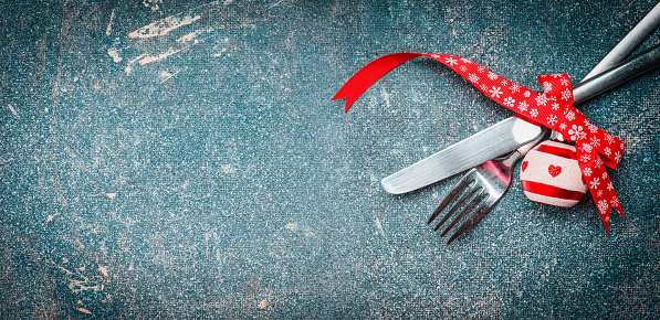 Christmas food background with table place setting: fork, knife and festive decoration, banner