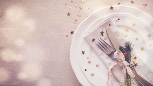 Christmas food dinner table place setting, holidays copy space background stock photo