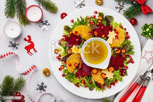 Christmas wreath salad with beetroot,apple,oranges and honey-mustard sauce.