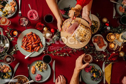 Typical swedish scandinavian christmas smörgåsbord buffet food Photo taken from above overhead table top shot Photot of typical smorgasbord with breaded ham, meatballs, sausauge,noisette, pickled herring and side dishes Julbord med griljerad skinka sill och lax