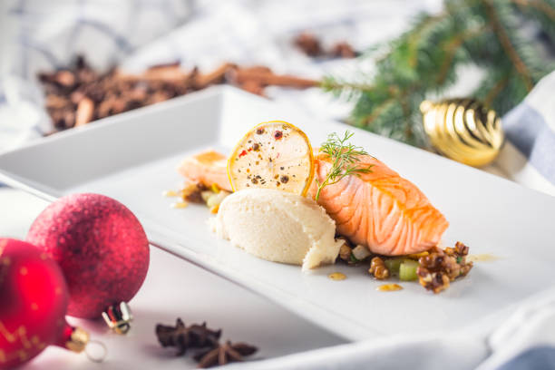 christmas food with salmon fillet and decoration home hotel or restaurant - christmas background стоковые фото и изображения