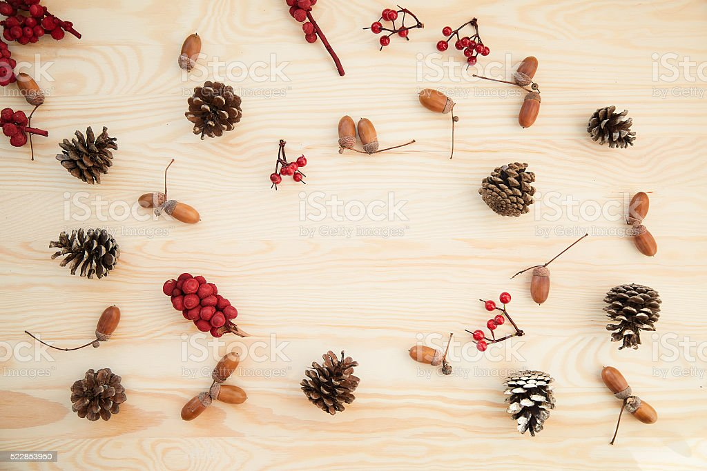 Christmas frame: cones, cinnamon, berries, acorn on the wood table stock photo