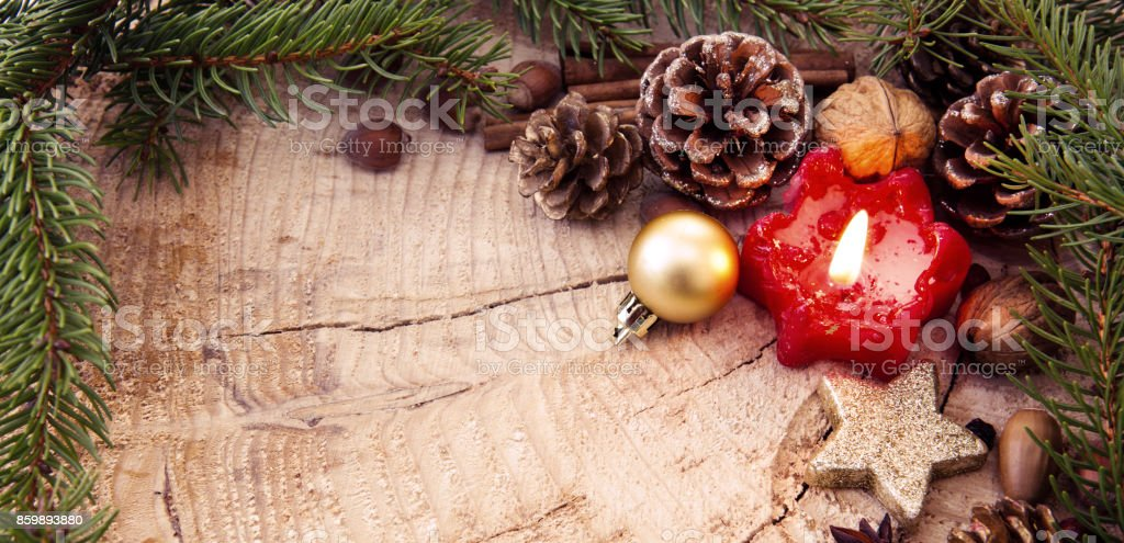 Christmas decoration with red Advent candle and fir branch frame, top...