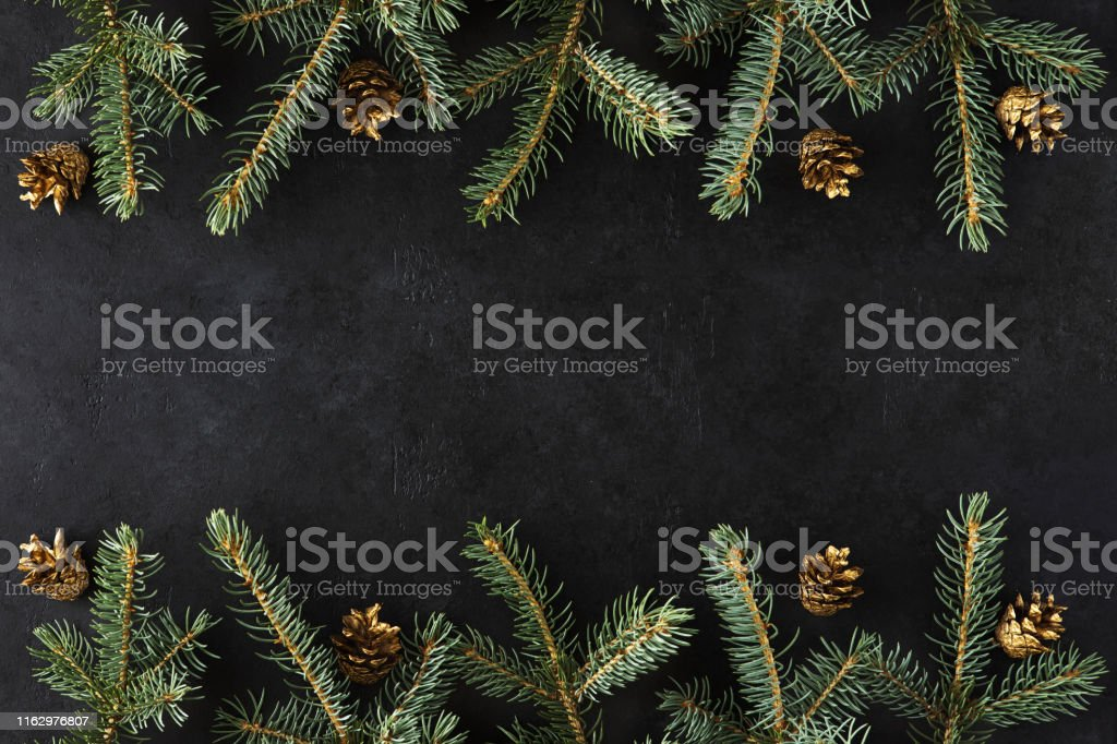 Christmas Frame Made Of Fir Branches Gold Cones On Black