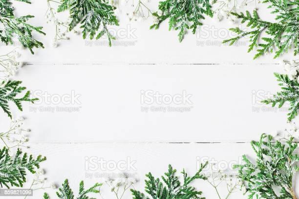Christmas frame made of thuja branches flat lay top view picture id859821096?b=1&k=6&m=859821096&s=612x612&h=qulo9k1xo5y3og s mqorhvyemzsxyytfdnlr2cthzc=