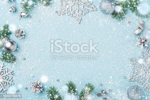 istock Christmas frame of decoration fir and silver New Year's ornaments. 1043770476