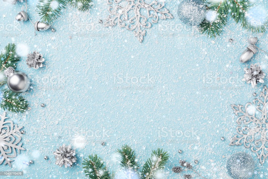 Christmas frame of decoration fir and silver New Year's ornaments. stock photo