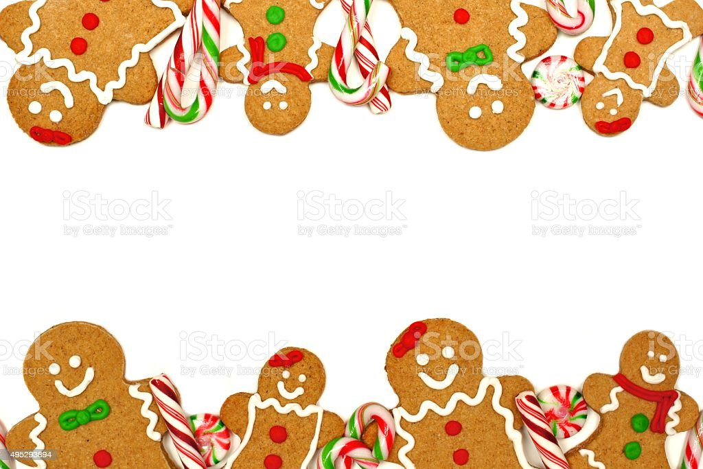 Christmas frame of gingerbread men and candies stock photo