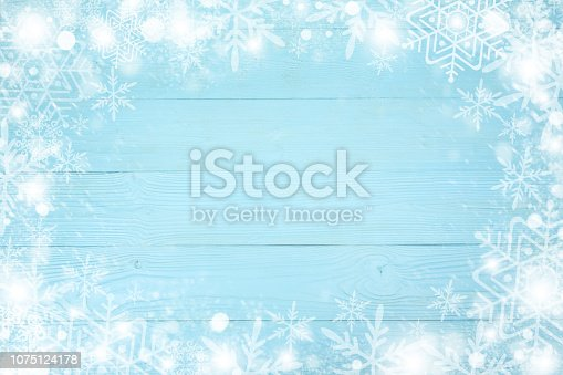 1076063742 istock photo Christmas frame of snowflake with copy space,  on blue board wooden background. Top view 1075124178