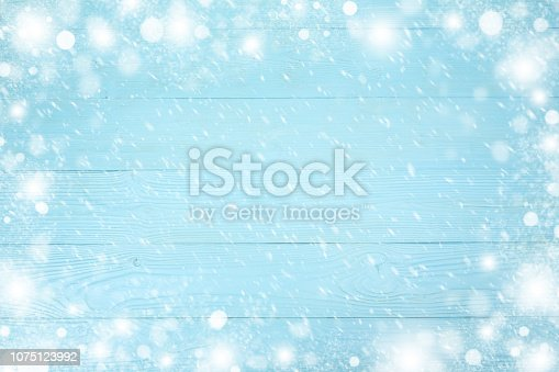 1076063742 istock photo Christmas frame of snowflake with copy space,  on blue wooden background. Top view 1075123992
