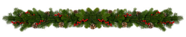 Christmas frame of tree branches Christmas Border frame of tree branches red berries and pine cones on white background with copy space isolated christmas decoration stock pictures, royalty-free photos & images