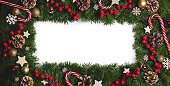 istock Christmas frame of tree branches 1182632107