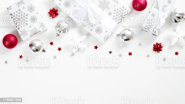 Christmas frame top border made of gifts balls stars confetti red and picture id1185621394?b=1&k=6&m=1185621394&s=612x612&h=kxidrnxuxqixstjlhpx0ififurf8ouq3ojrxi2stqpo=