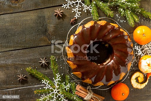 istock Christmas frame. Traditional homemade cupcake with chocolate ici 625624932