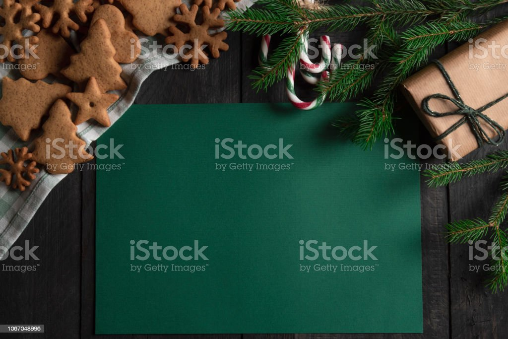 Directly above image with gingerbread cookies, candy canes, and...