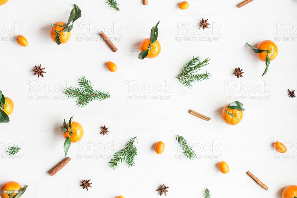 Christmas frame with tangerines, fir branches, cinnamon sticks, anise star stock photo